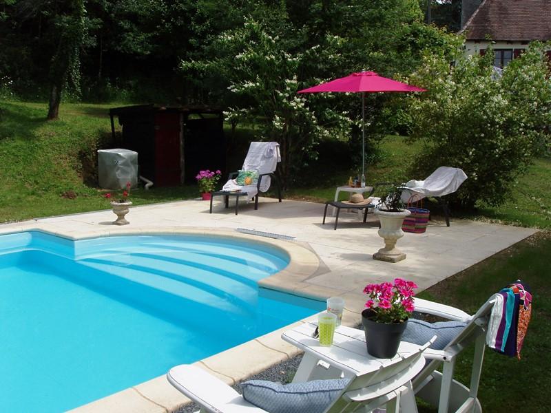 Moulin de Lassier ( ) Aanbiedingen vakantiewoningen - Het zwembad met terras