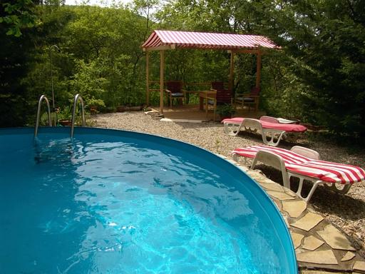 Leo Verton ( Doorwerth ) Aanbiedingen vakantiewoningen - Het huisje in het groen - Het zwembadje