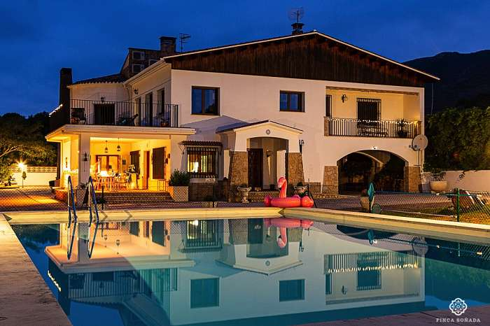 Finca Soñada - The main house with the large swimming pool in the foreground. Do you also like skinny dipping at sunset?